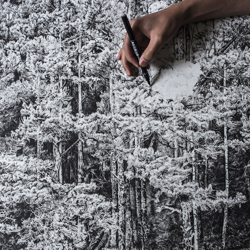 Brain Cheung painting a tree landscape at AARK in Korpo