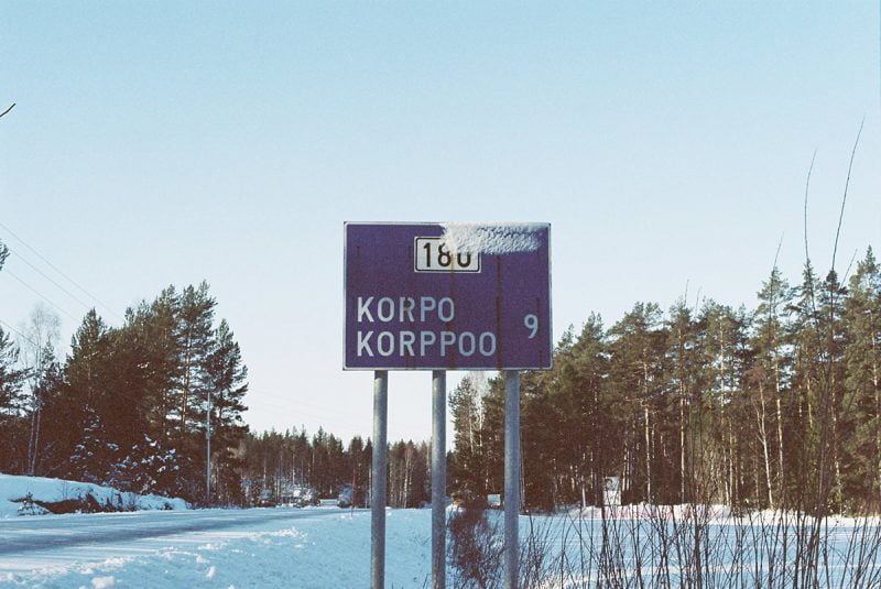 Nine Kilometers to Korpo road sign under the snow by Brian Cheung