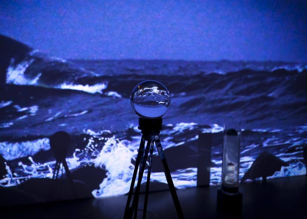 Glass ball, tripod, video. Installation view from exhibition